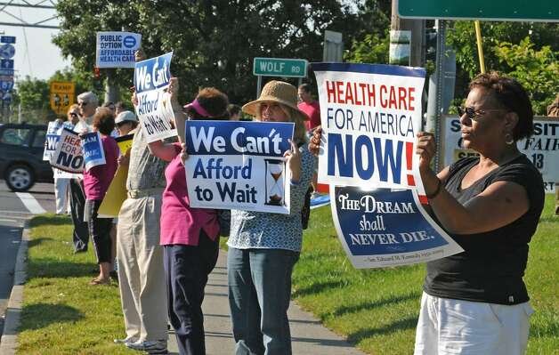Supporters of health care reform rally Wednesday at the corner of Central Avenue and Wolf Road in Colonie as part of a national event sponsored by MoveOn.org. Other groups participating are the Center for Community Change, Democracy for America, Doctors for America, Health Care for American Now, and TrueMajority. The groups are urging House members, including Scott Murphy, D-Glens Falls, to  support a strong public health insurance option they say will help lower skyrocketing health care costs and expand coverage to millions of Americans.  (Lori Van Buren /Times Union) Photo: LORI VAN BUREN
