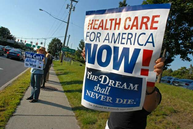 Health care reform supporters demonstrate Wednesday in Colonie. (Lori Van Buren/Times Union) Photo: LORI VAN BUREN