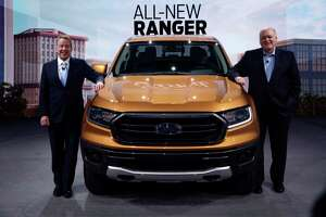 Ford Motor Co. Executive Chairman Bill Ford, left, stands with President and CEO Jim Hackett, next to the 2019 Ford Ranger pickup at the North American International Auto Show, Sunday, Jan. 14, 2018, in Detroit. (AP Photo/Carlos Osorio)