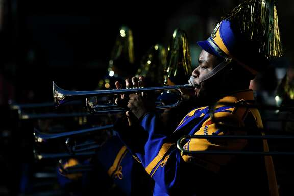 Booker T. Washington High School band members play in the MLK Grande Parade on Monday.