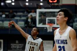 Ross Williams (10) watches his three-pointer go in in the first half as the Bishop O'Dowd Dragons played the Pleasant Grove (Utah) Vikings at the Martin Luther King, Jr. Classic at St. Mary's College in Moraga, Calif., on Monday, January 15, 2018.