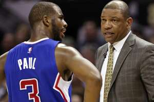 Los Angeles Clippers' Chris Paul talks with head coach Doc Rivers during second half action of Game 4 in the Western Conference playoffs against the San Antonio Spurs Sunday April 26, 2015 at the AT&T Center.  The Clippers won 114-105.