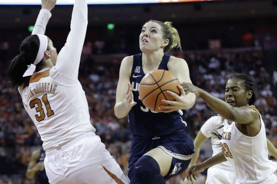 UConn's Katie Lou Samuelson, center, is fouled by Texas guard Ariel Atkins, right, during the first half on Monday. Photo: Eric Gay / Associated Press / Copyright 2018 The Associated Press. All rights reserved.