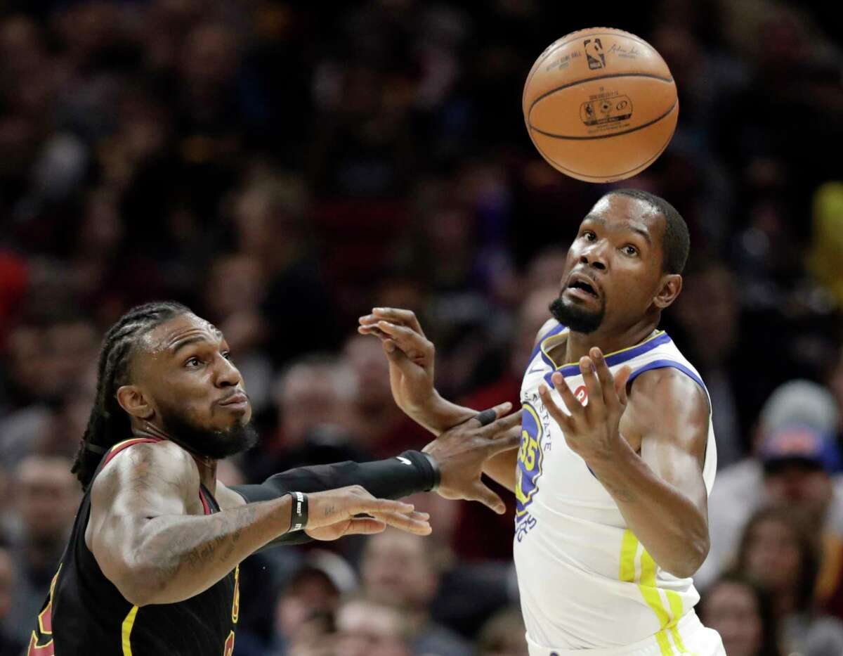 Cleveland Cavaliers' Jae Crowder, left, knocks the ball loose from Golden State Warriors' Kevin Durant in the first half of an NBA basketball game, Monday, Jan. 15, 2018, in Cleveland.