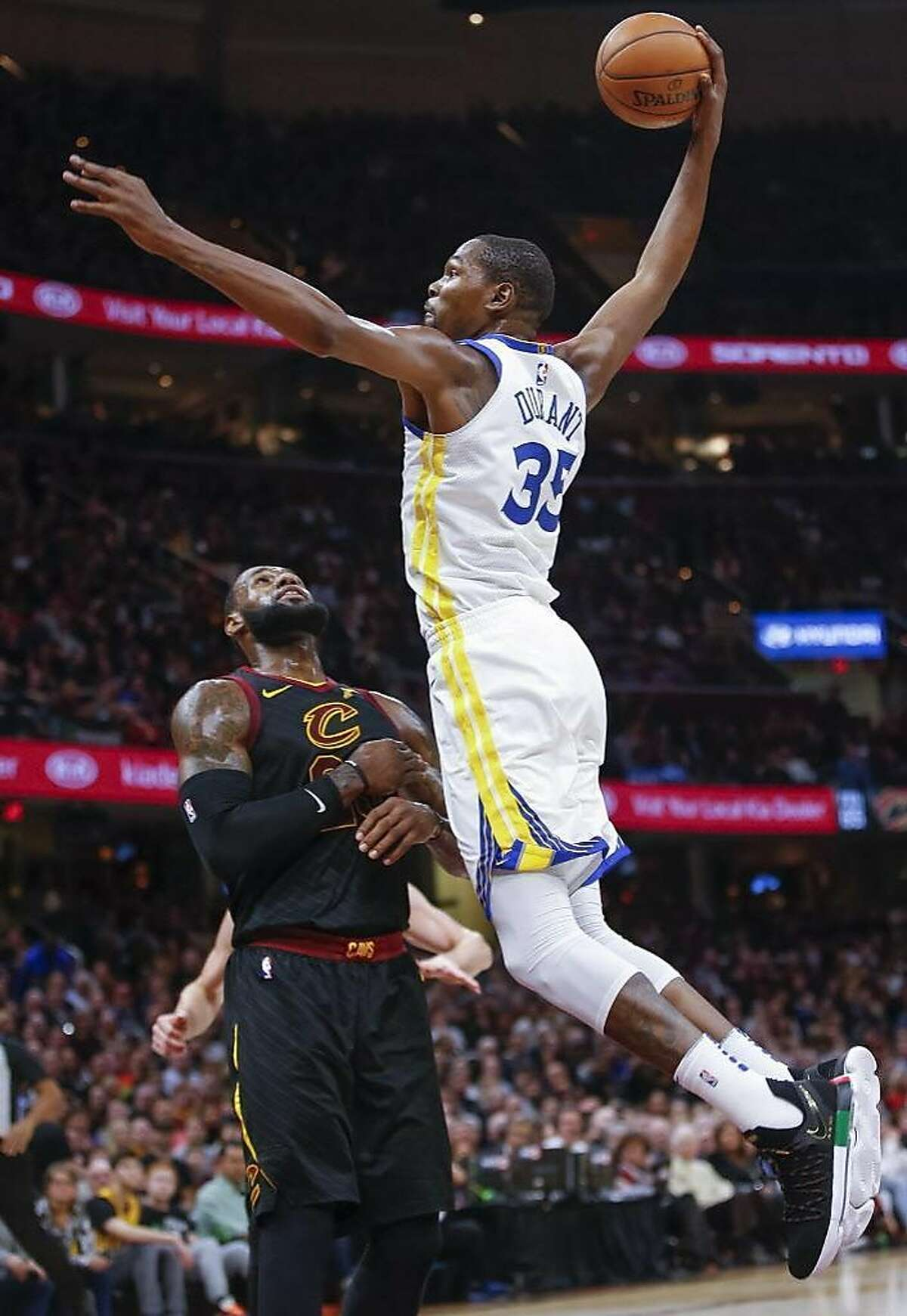 Kevin Durant of the Golden State Warriors goes up for the dunk over LeBron James #23 of the Cleveland Cavaliers at Quicken Loans Arena on January 15, 2018 in Cleveland, Ohio.