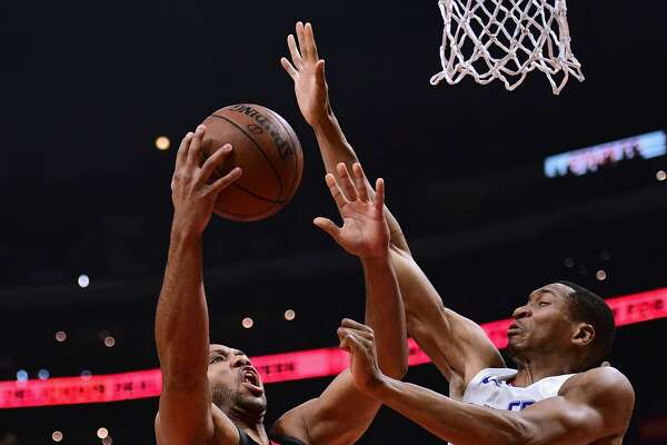 LOS ANGELES, CA - JANUARY 15:  Wesley Johnson #33 of the LA Clippers prepares to block the shot of Eric Gordon #10 of the Houston Rockets during the first half at Staples Center on January 15, 2018 in Los Angeles, California.  (Photo by Harry How/Getty Images)