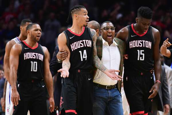 LOS ANGELES, CA - JANUARY 15: Gerald Green #14 of the Houston Rockets is restrained by an assistant coach during a 113-102 LA Clippers win at Staples Center on January 15, 2018 in Los Angeles, California.  (Photo by Harry How/Getty Images)
