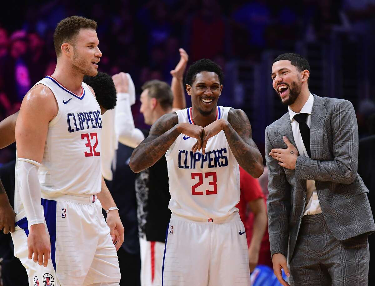 LOS ANGELES, CA - JANUARY 15: (R-L) Austin Rivers #25, Lou Williams #23 and Blake Griffin #32 of the LA Clippers laugh during a stop in play in a 113-102 Clipper win over the Houston Rockets at Staples Center on January 15, 2018 in Los Angeles, California. (Photo by Harry How/Getty Images)