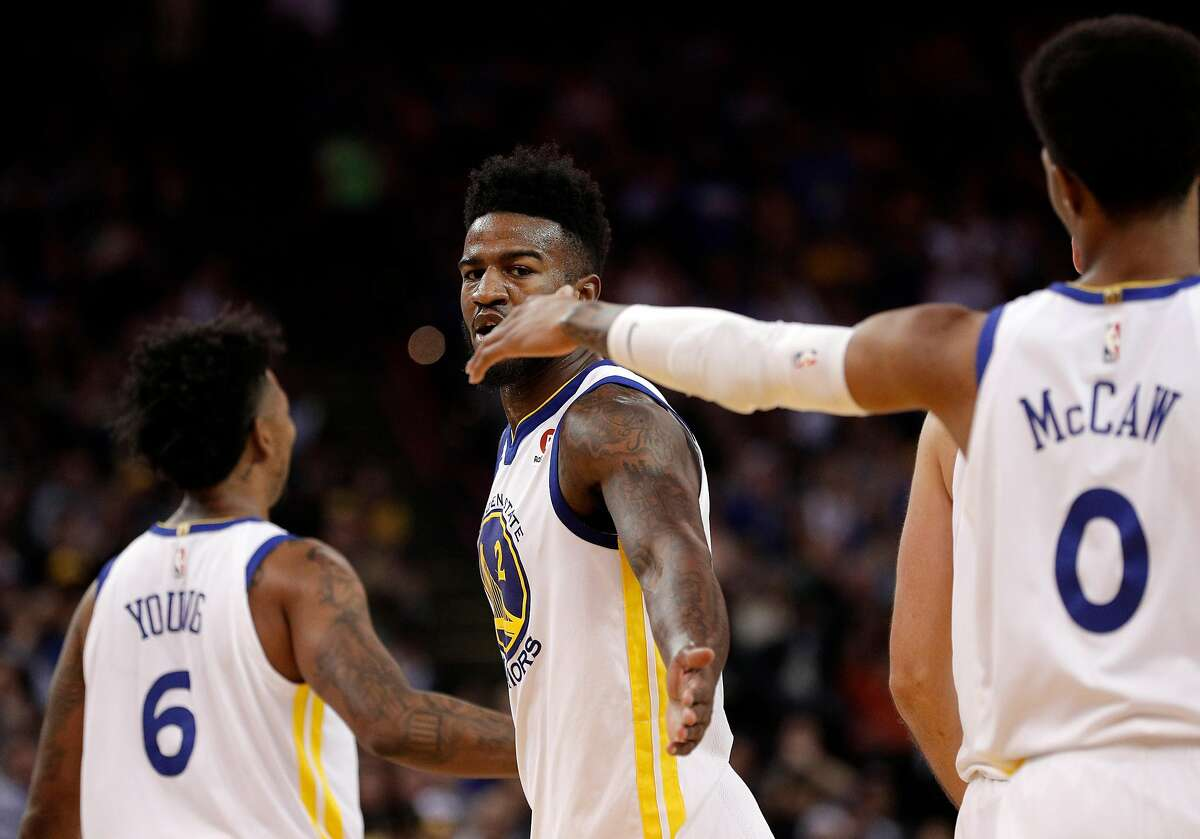 Jordan Bell (2) high fives Patrick McCaw (0) after getting fouled on a shot in the first half as the Golden State Warriors played the Denver Nuggets at Oracle Arena in Oakland, Calif., on Monday, January 8, 2018.