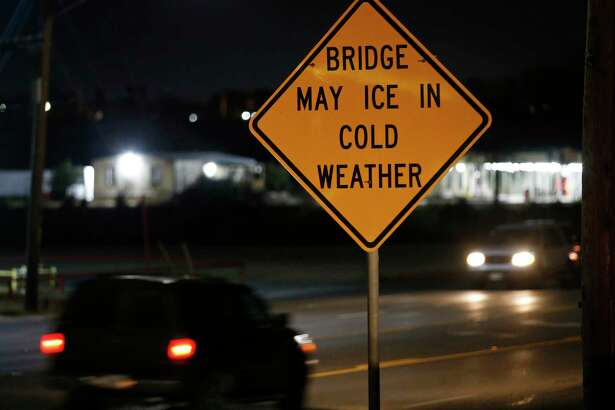 A view of the bridge may ice in cold weather sign on Southeast Military Drive near the San Antonio River Monday Jan. 15, 2018.