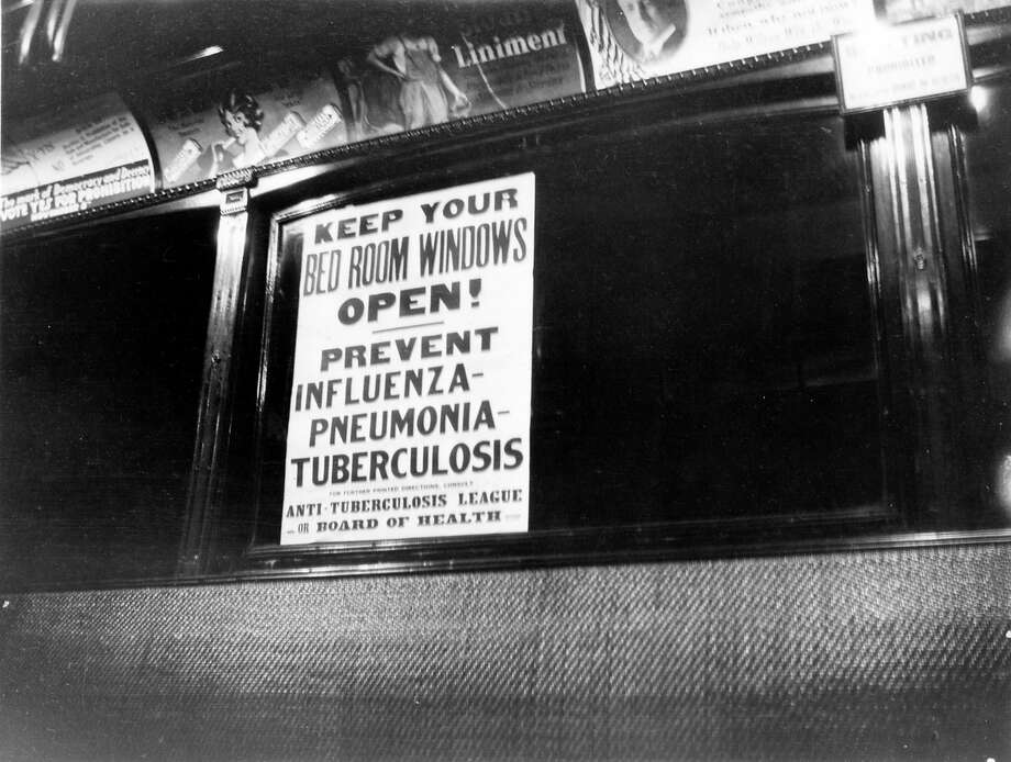 View of a health warning notice about influenza, from the Anti-Tuberculosis League, posted on the inside of a public transport vehicle (likely a train). Photo: Cincinnati Museum Center/Getty Images