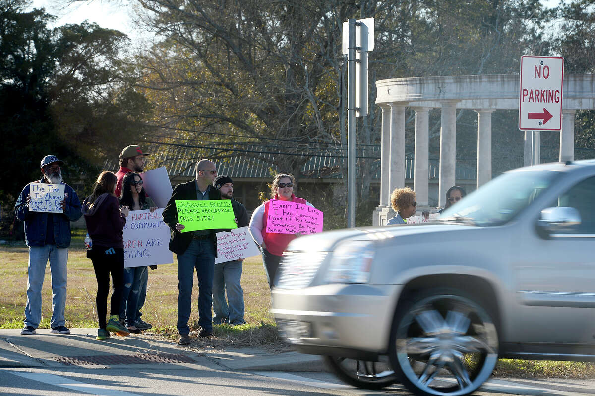 Protesters gather near the Confederate Memorial of the Wind on Martin Luther King Jr. Drive in Orange on Monday afternoon. Photo taken Monday 1/15/18 Ryan Pelham/The Enterprise
