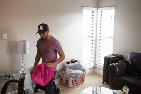 Jonathan Jimenez packs up as he prepares to move to a new apartment. Jimenez has a work permit under DACA that will expire in August, so he's hoping a judge's ruling requiring the government to renew the permits will stay in place a few more days (the permits can be renewed 180 days before they expire).