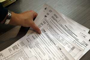 FILE - With tax season about to start up, the Connecticut Better Business Bureau is warning that income tax refund fraud has been rampant over the past several years. (AP Photo/Brennan Linsley)
