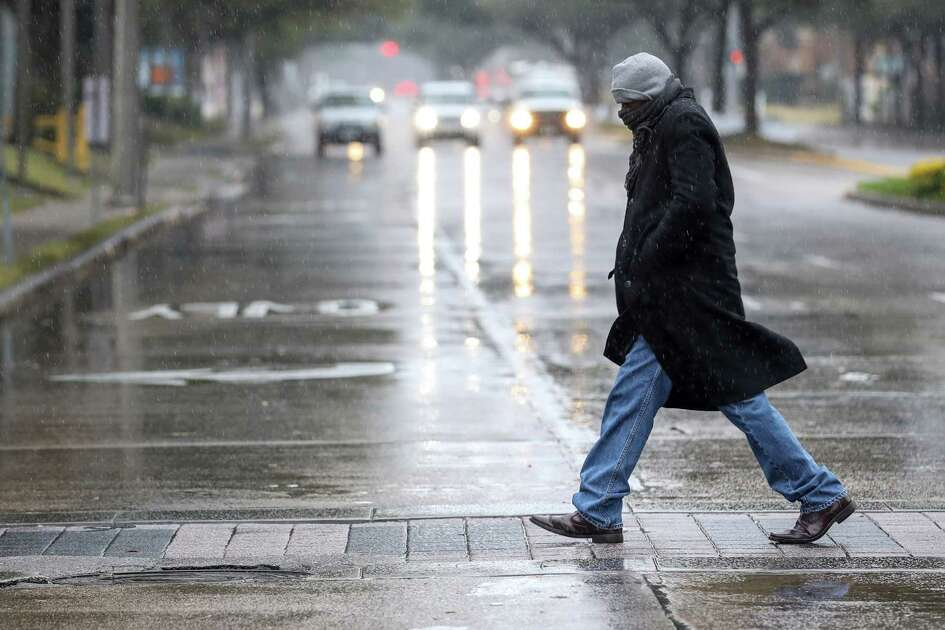 """Kevin Johnson walks near the Galleria as he looks for an eye-glasses shop, Tuesday, Jan. 16, 2018, in Houston. """"It's freezing out here,"""" Johnson said. """"I haven't seen it this cold in a long time."""""""