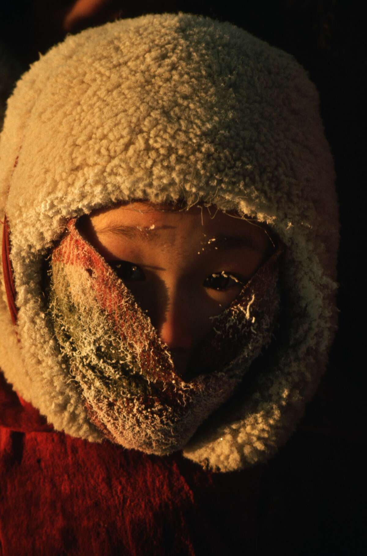 Yakut child wrapped up against the cold (Photo by Dean Conger/Corbis via Getty Images)