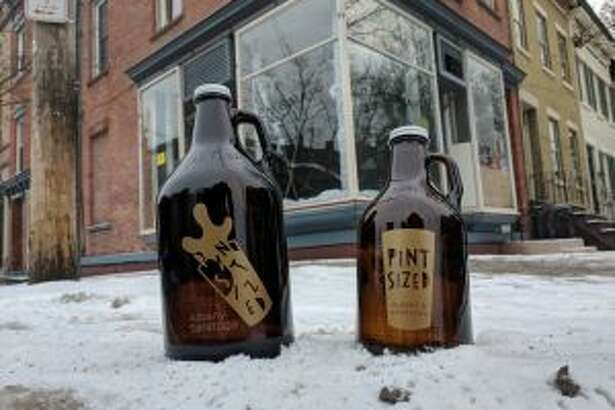 Growlers in front of the new Pint Sized location. (Photo courtesy August Rosa.)