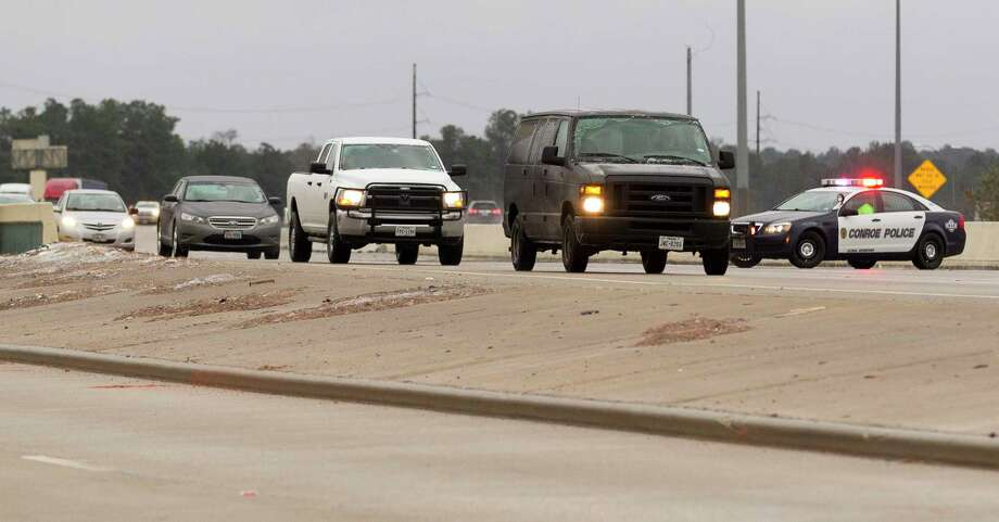 Vehicles are diverted off I-45 onto the feeder after an accident as residents battle winter storm conditions that brought freezing rain and ice through Montgomery County, Tuesday, Jan. 16, 2018. The National Weather Service issued a Winter Storm Warning for southeast Texas until midnight Wednesday. Photo: Jason Fochtman, Staff Photographer / © 2018 Houston Chronicle