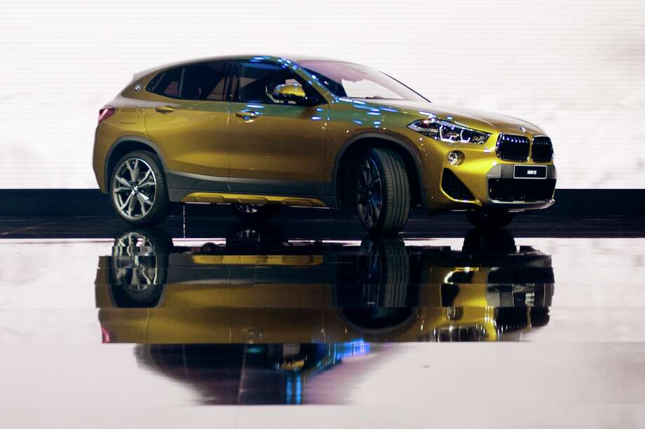 The BMW X2 is introduced during the 2018 North American International Auto Show in Detroit, Michigan, on January 15, 2018. The Detroit Auto Show got rolling on January 14, with international trade and tax cuts dominating the conversation, even as carmakers raced to meet Americans' seemingly insatiable appetite for trucks and SUVs. Photo: JIM WATSON/AFP/Getty Images