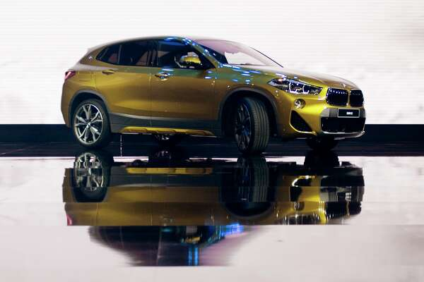 The BMW X2 is introduced during the 2018 North American International Auto Show in Detroit, Michigan, on January 15, 2018. The Detroit Auto Show got rolling on January 14, with international trade and tax cuts dominating the conversation, even as carmakers raced to meet Americans' seemingly insatiable appetite for trucks and SUVs.