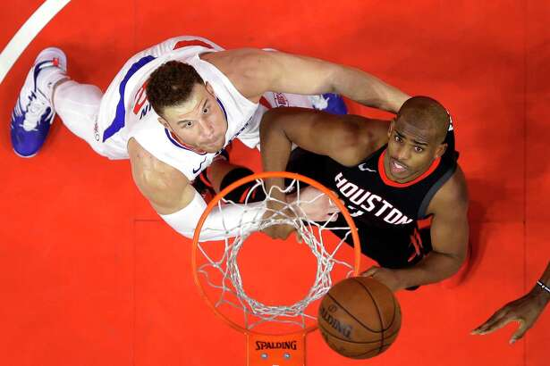 Los Angeles Clippers forward Blake Griffin, left, and Houston Rockets guard Chris Paul wait for a rebound during the second half of an NBA basketball game, Monday, Jan. 15, 2018, in Los Angeles. The Clippers won 113-102. (AP Photo/Mark J. Terrill)