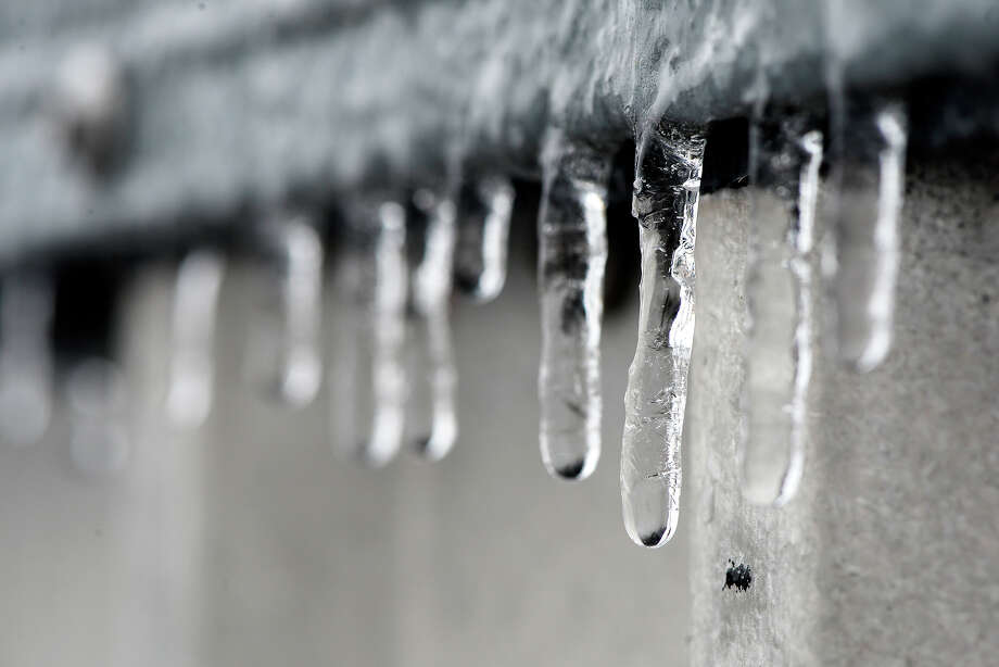 Icicles hang off a ledge as freezing rain hits Beaumont on Tuesday.  Photo taken Tuesday 1/16/18 Ryan Pelham/The Enterprise Photo: Ryan Pelham, Ryan Pelham/The Enterprise / ©2017 The Beaumont Enterprise/Ryan Pelham