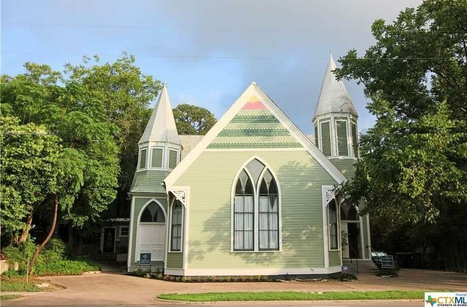 PHOTOS: Churches for sale across America A church-turned-house is currently for sale in San Marcos, complete with vaulted ceilings and late-Gothic Revival architecture. The three-bedroom, two-story home was built in 1901, according to the Realtor.com listing, and is just blocks away from downtown San Marcos.See the other former churches currently for sale across the country... Photo: Realtor.com