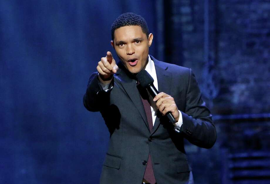"Trevor Noah, host of Comedy Central's ""The Daily Show,"" acknowledges the audience during a taping at Chicago's The Athenaeum Theatre on Oct. 16, 2017. Comedy Central is owned by Viacom, which last year announced a new production partnership with Stamford-based Charter Communications. Photo: Jeff Schear / Getty Images For Comedy Central / 2017 Getty Images"