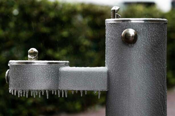 Icicles hang off a water fountain as freezing weather moves across the region Tuesday, Jan. 16, 2018 in Houston. The National Weather Service issued a Winter Storm Warning for southeast Texas until midnight Wednesday. (Michael Ciaglo/Houston Chronicle)