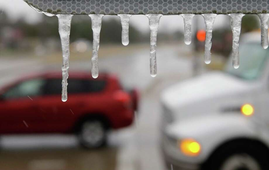 Icicles are shown on a street sign at the intersection of North Gessner and Beltway 8 Tuesday, February 16, 2017. ( Melissa Phillip /Houston Chronicle ) Photo: Melissa Phillip, Staff / Houston Chronicle 2018