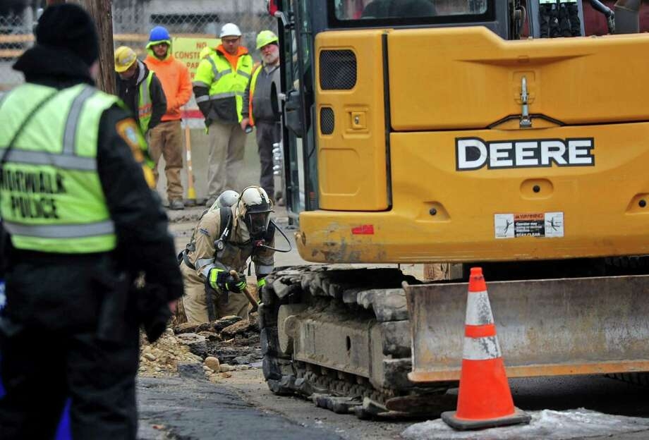 A Eversource employee works in a trench on Putnam Ave. after a gas line was breached by construction crews doing utility work Tuesday, January, 16, 2018, in Norwalk, Conn. Photo: Erik Trautmann / Hearst Connecticut Media / Norwalk Hour