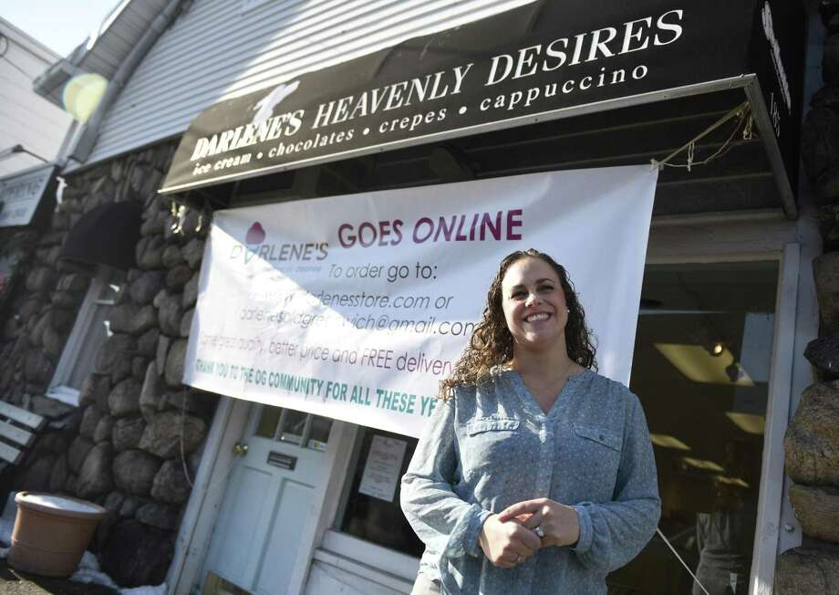 Owner Isabel Ballesteros poses outside Darlene's Heavenly Desires in Old Greenwich, Conn. Tuesday, Jan. 9, 2018. The treat shop is making a transition to online and will no longer feature a physical storefront. Photo: Tyler Sizemore / Hearst Connecticut Media / Greenwich Time