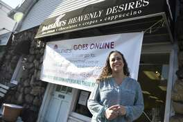 Owner Isabel Ballesteros poses outside Darlene's Heavenly Desires in Old Greenwich, Conn. Tuesday, Jan. 9, 2018. The treat shop is making a transition to online and will no longer feature a physical storefront.