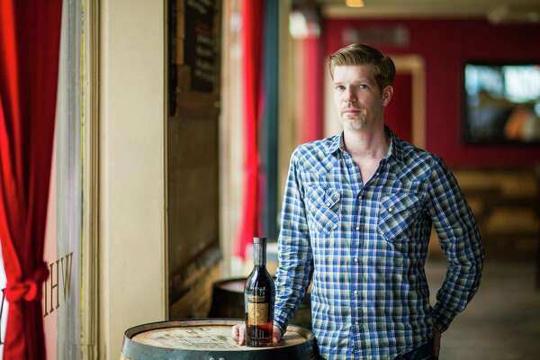 Reserve 101 co-owner Mike Raymond. The downtown whiskey bar is marking its 10th anniversary.