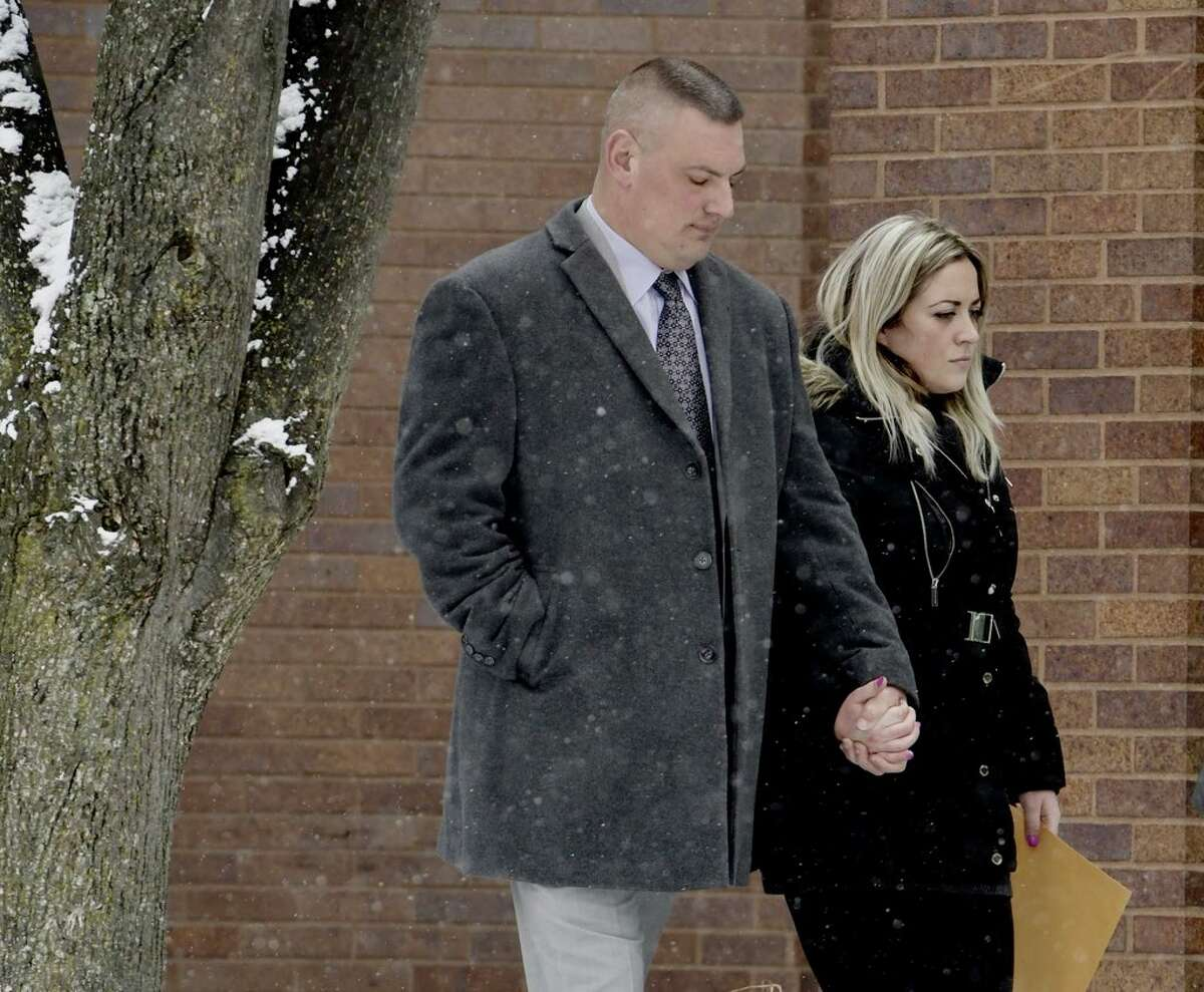 Schenectady Police Department Lt. Mark MCracken leaves City Court with his girlfriend on Jan. 16, 2018.
