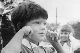 Burke Groom covers his ears as the siren starts from a firetruck in an outside demonstration. August 1977