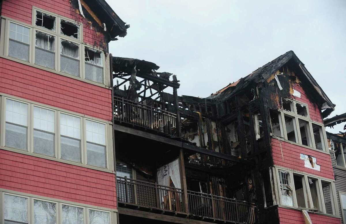 Norwalk Chief Building Official Bill Ireland said the petroleum-based vinyl siding on the exterior of StoneWood Condominiums, heavily damaged in a fire last month, was like