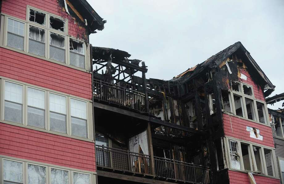 """Norwalk Chief Building Official Bill Ireland said the petroleum-based vinyl siding on the exterior of StoneWood Condominiums, heavily damaged in a fire last month, was like """"putting gasoline on the building."""" Photo: Erik Trautmann / Hearst Connecticut Media / Norwalk Hour"""
