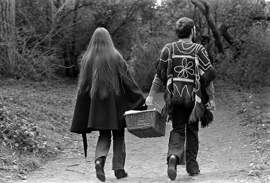 A young couple walk with a picnic basket in Golden Gate Park in S.F., circa February 1969. Photo: Robert Altman, Getty Images