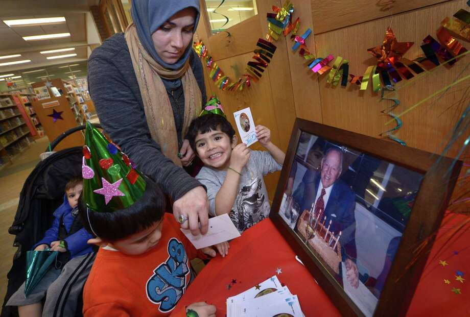 Alia Mahdi and her children, Ibrahim, 1, Yusuf, 4, and Musa, 3, make bookplates as they enjoy the Harold W. McGraw, Jr. Birthday Party at Darien Library Saturday, January 13, 2018, at the Darien Library in Darien, Conn. Families were invited to celebrate the annual birthday of the Library and their generous donor, Harold W. McGraw, Jr. Photo: Erik Trautmann / Hearst Connecticut Media / Norwalk Hour