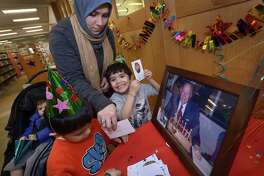 Alia Mahdi and her children, Ibrahim, 1, Yusuf, 4, and Musa, 3, make bookplates as they enjoy the Harold W. McGraw, Jr. Birthday Party at Darien Library Saturday, January 13, 2018, at the Darien Library in Darien, Conn. Families were invited to celebrate the annual birthday of the Library and their generous donor, Harold W. McGraw, Jr.