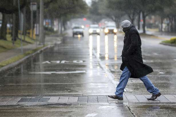 """Kevin Johnson walks near the Galleria as he looks for an eye-glasses shop, Tuesday, Jan. 16, 2018, in Houston. """"It's freezing out here,"""" Johnson said. """"I haven't seen it this cold in a long time."""" The National Weather Service issued a Winter Storm Warning for southeast Texas until midnight Wednesday. ( Jon Shapley/Houston Chronicle via AP)"""