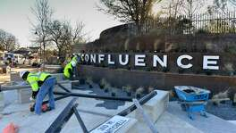 Workers put the finishing touches on Confluence Park during a media preview Friday morning. The park is designed to inspire students and visitors to become involved with regional waterways and practice environmental stewardship.