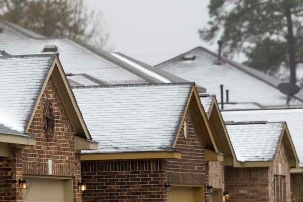 Ice forms on the roofs of homes in Porter as a winter storm brought freezing rain and ice throughout the greater Houston area, Tuesday, Jan. 16, 2018. The National Weather Service issued a Winter Storm Warning for southeast Texas until midnight Wednesday.