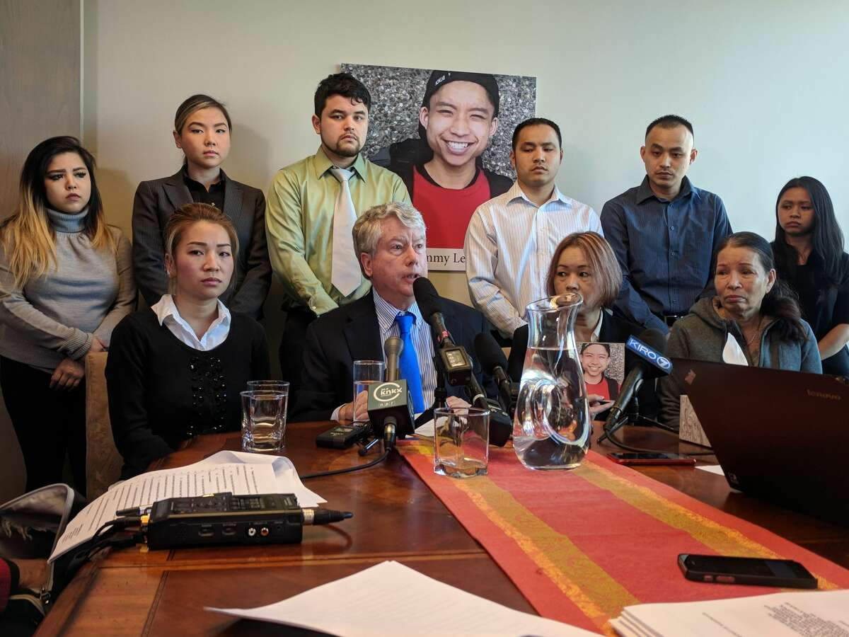 Family members of Tommy Le and their attorneys announced a lawsuit against the King County Sheriff's Office Tuesday, claiming Le's constitutional rights were violated when he was killed by deputies while unarmed in Burien. In the back row are cousin Jennie Le, attorney Linda Tran, cousin Missouri Le, brother Quoc Nguyen, brother Tam Nguyen and sister Dun Nguyen. In the front are aunt Xuyen Le, attorney Jeffery Campiche, mother Dieu Ho and grandmother Kim Tuyet Le.