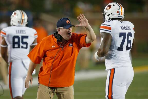 COLUMBIA, MO - SEPTEMBER 23: Auburn Tigers offensive line coach Herb Hand celebrates with  lineman Prince Tega Wanogho (76) after a touchdown during the first half of a college football game against the Auburn Tigers, Saturday, September 23,  2017, at Memorial Stadium in Columbia Missouri. (Photo by Scott Kane/Icon Sportswire via Getty Images)