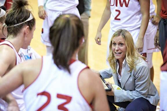 UIW women's basketball coach Christy Smith gives her players instructions during a timeout.