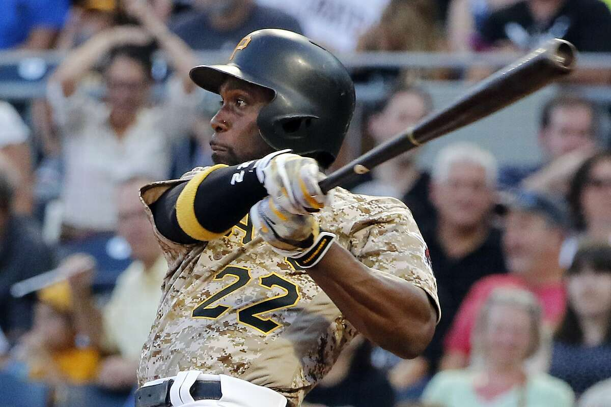 FILE - In this Aug. 3, 2017, file photo, Pittsburgh Pirates' Andrew McCutchen watches his RBI-single off Cincinnati Reds starting pitcher Sal Romano during the third inning of a baseball game in Pittsburgh. The Giants acquired McCutchen from the Pirates for right-hander Kyle Crick, minor league outfielder Bryan Reynolds and $500,000 in international signing bonus allocation. (AP Photo/Gene J. Puskar, File)