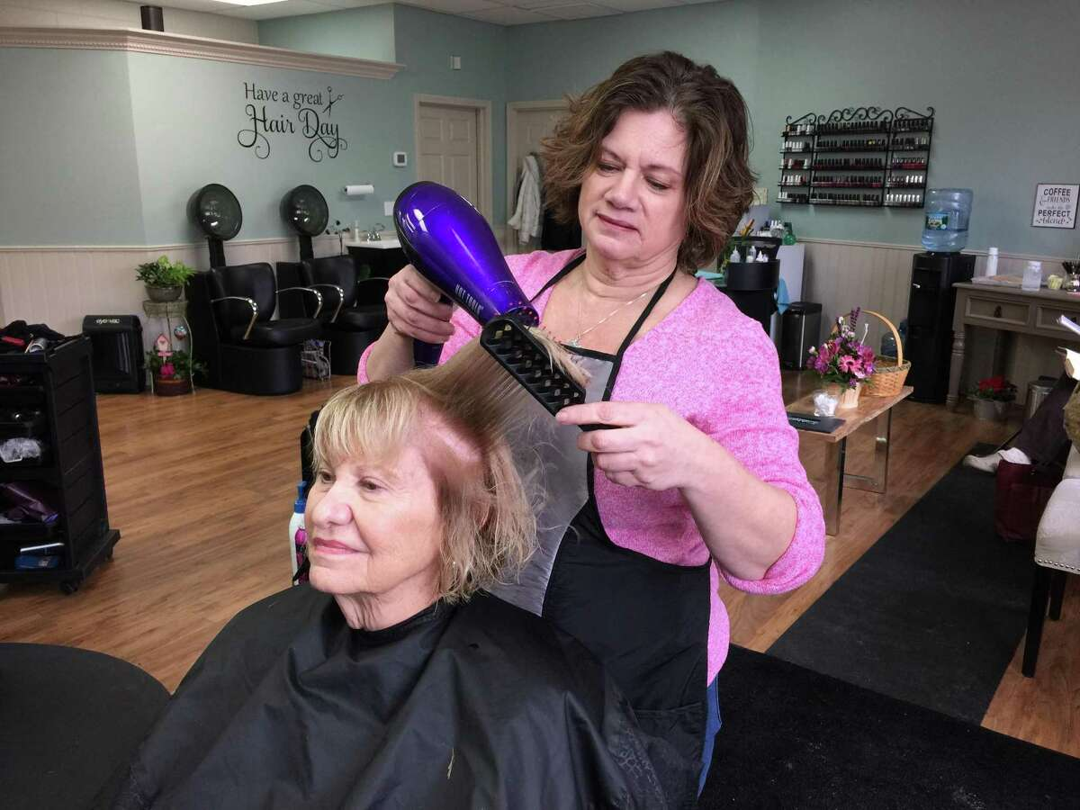 Lori Richnavsky recently struck out on her own after decades as a hairdresser, as she opened the Strands Unisex Hair Salon on East Main Street in Torrington.