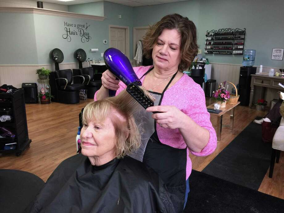 Lori Richnavsky recently struck out on her own after decades as a hairdresser, as she opened the Strands Unisex Hair Salon on East Main Street in Torrington. Photo: Ben Lambert / Hearst Connecticut Media